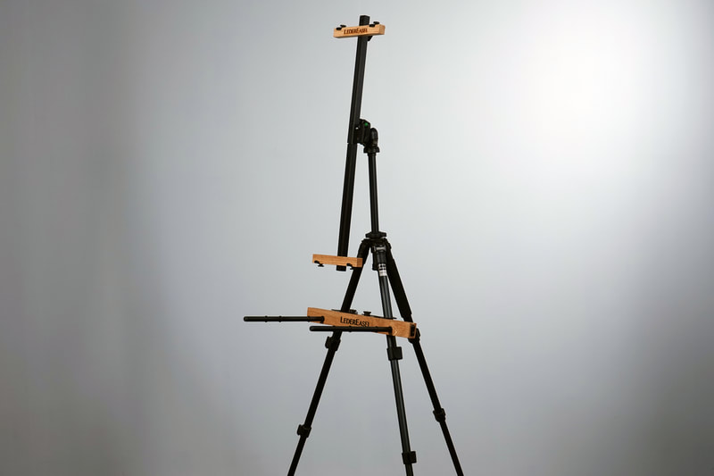 EASEL AND PALETTE HOLDER SHOWN ATTACHED TO TRIPOD